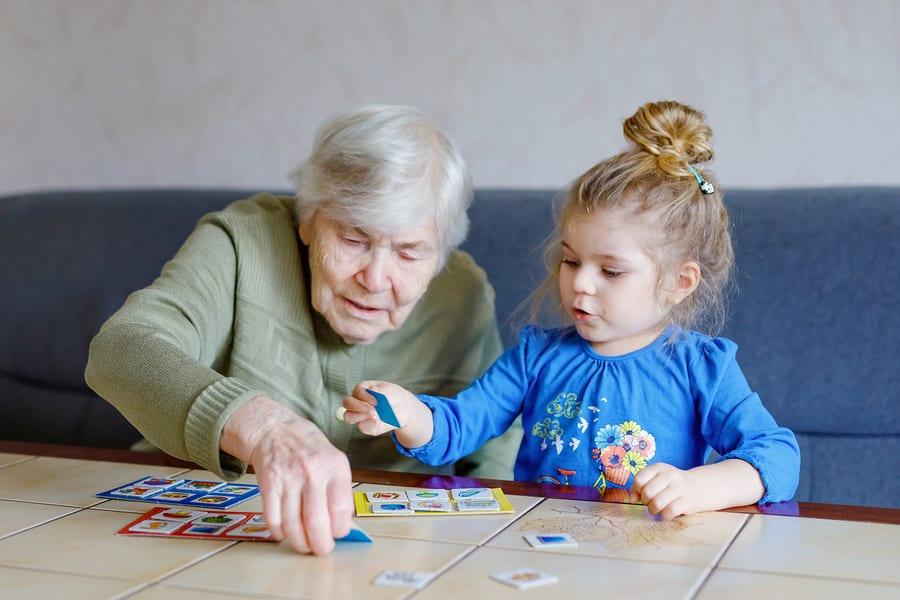 Child plays memory game with grandma