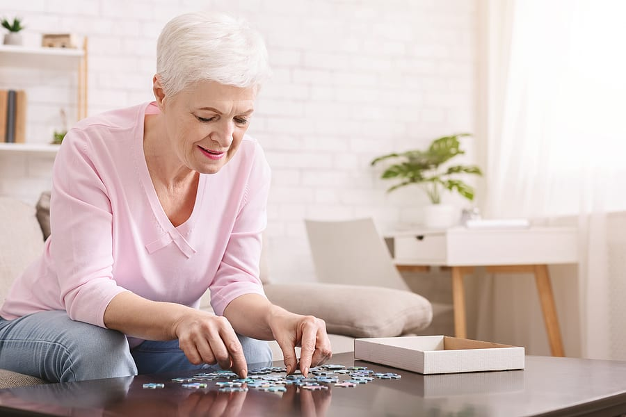 elderly woman playing games, jigsaw puzzle